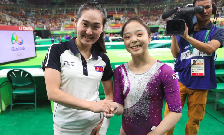 TOPSHOT - This picture taken on August 7, 2016 shows South Korean gymnast Lee Eun-Ju (C) and North Korea's Hong Un-Jong (L) posing for a photo after their competition during the women's qualification for the artistic gymnastics at the Rio 2016 Olympic Games at the Rio Olympic Arena in Rio de Janeiro. South Korean gymnast Lee Eun-Ju, who found herself in the international spotlight after taking a selfie with a North Korean competitor in Rio, said on August 12 she was surprised by the extraordinary response to such a simple act. / AFP PHOTO / YONHAP / YONHAP / REPUBLIC OF KOREA OUT  NO ARCHIVES  RESTRICTED TO SUBSCRIPTION USEYONHAP/AFP/Getty Images ** OUTS - ELSENT, FPG, CM - OUTS * NM, PH, VA if sourced by CT, LA or MoD **
